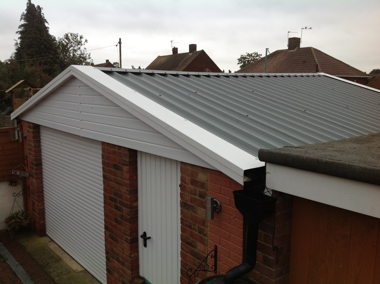 09 brick garage cracked and split roof rochester for Brick garages prices